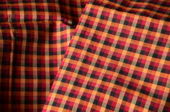 Organic Cotton in Chettinad Plaids. Awesome fall colors. Red, Black and Mustard. HANDWOVEN. Plaids repeat is 1 in. x 1 in.