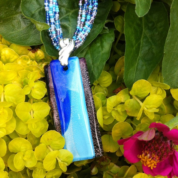 Blue and Purple Glass Pendant on Strands of Matching Seed Beads