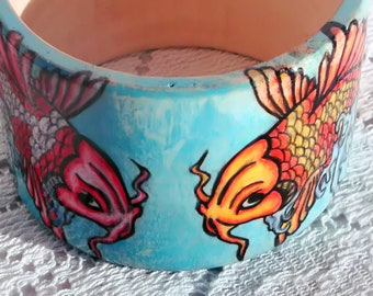bangle hand drawn tattoo style art the water lily is opposite direction of the fish