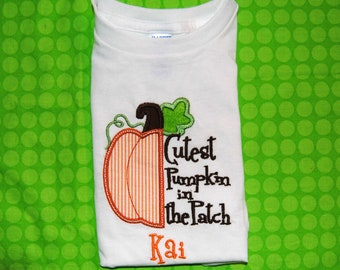 Embroidered Shirt or Bodysuit with the saying The Saying Cutest Pumpkin in the Patch.