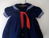vintage baby girl sailor dress with red sash and collar detail