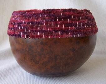 Medium cordovan gourd bowl, woven band of suede yarn at rim.  1613.