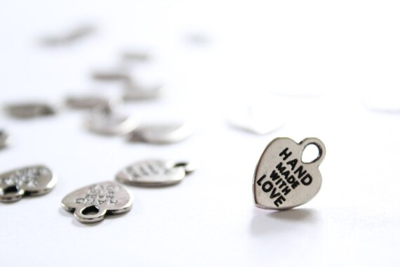 Wedding Favors Decor. 100 Heart Charms. Hand Made With Love. metal heart tags. silver. stamp hearts. wedding favors. sewing charms