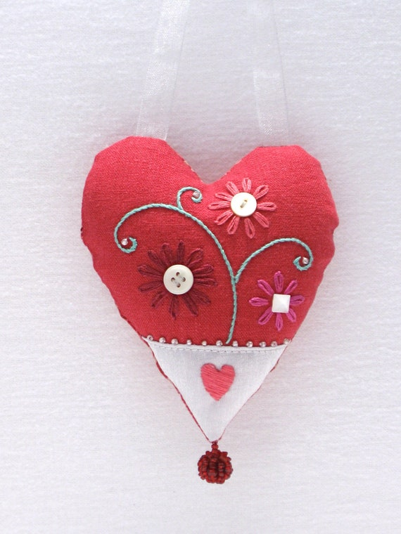 Mini heart pillow with embroidered flowers