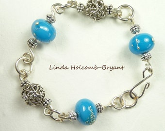 Silver Bracelet of Turquoise Lampwork Beads