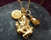 Ganesh. 24k gold plated Ganesh pendant with lotus charm and hessonite garnet