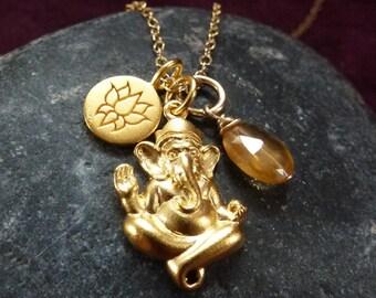 Ganesh. 24k gold plated Ganesh pendant with lotus charm and hessonite garnet