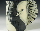 Black and white bird cup with wing and lady