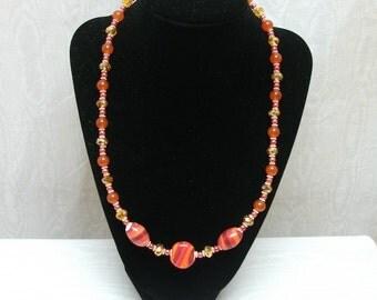 Orange and coral Swarovski ceramic glass pearl necklace