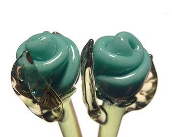 Matching pair of glass rose hair sticks Teal
