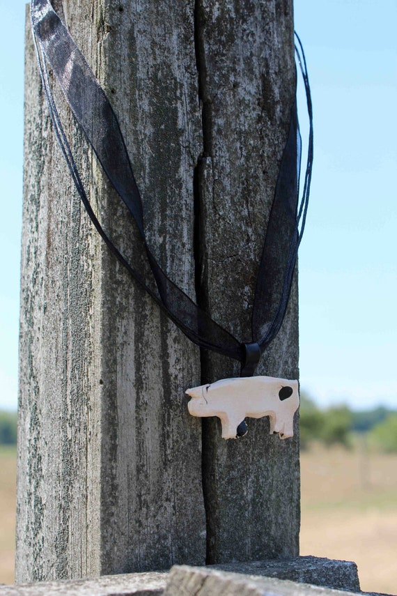 Pretty pig pendants and ribbon necklaces