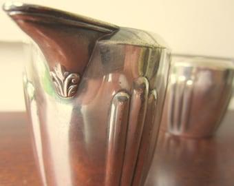 Classic Art Deco style silver cream and sugar set.
