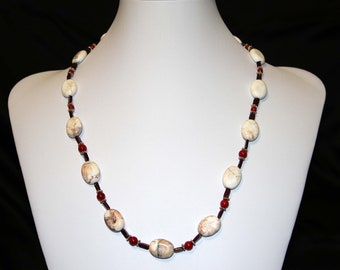 23 inch Howlite Sterling silver and Garnet necklace with matching earrings