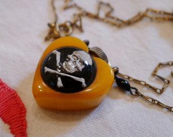 """Yellow Bakelite Heart with Skull and Crossbones Poison Perfume Necklace-- 18 1/4"""" long"""