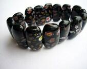 black glass bead bracelet with flowers.