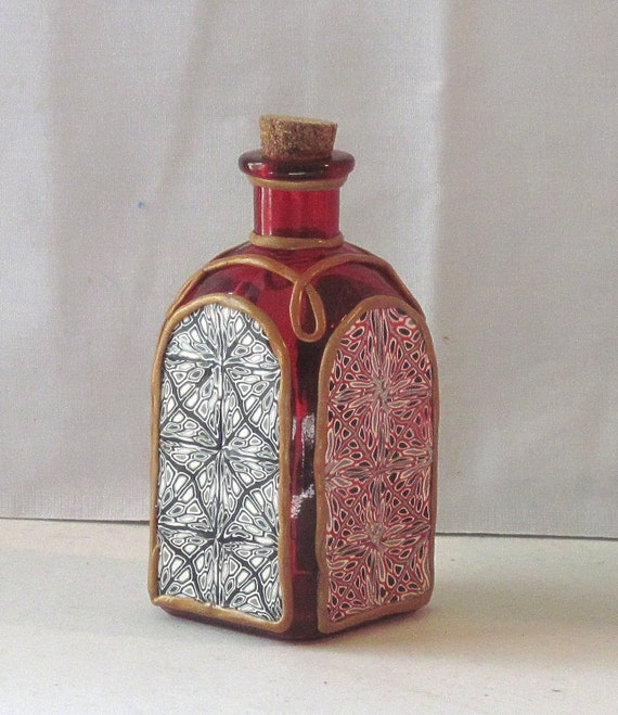 Red glass sorcerer's bottle  with cork