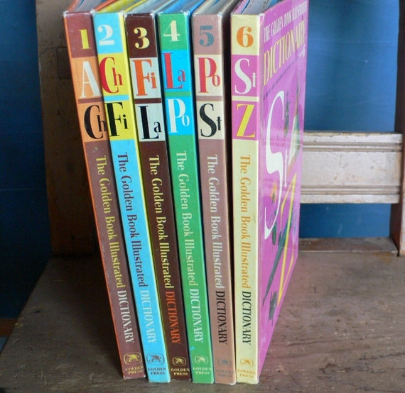 1961 Golden Book Dictionary six volumes bright colors book decor children's library from Diz Has Neat stuff