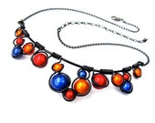 "Blue, Orange and Red ""Miracle Beads"" Wire wrapped necklace with black wire and adjustable Black chain"