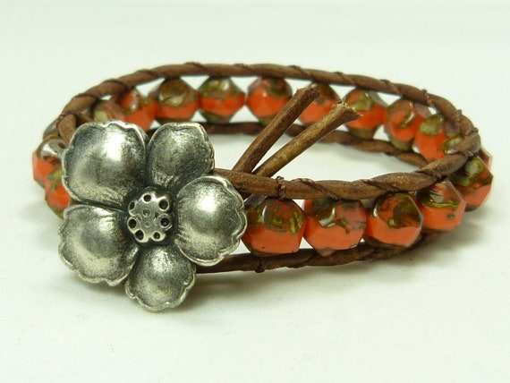Leather and bead wrap bracelet, coral red nugget beads, flower closure, single wrap bracelet, wear alone or with others. Tropical feel.