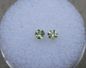 2 Peridot round loose gems 3mm each