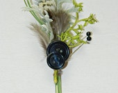 Men's boutonniere with feathers, greens and vintage buttons