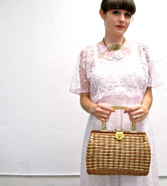 the last straw. vintage 60s cute straw purse with tortoise lucite handle & brass hardware