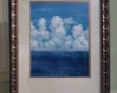 Cloud Print, is a copy of my original oil painting Clouds over Cozumel, which comes already framed and ready to hang.