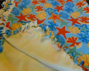 Fleece blanket Starfish,jellyfish and snails fleece,  on the other side is all light yellow in color