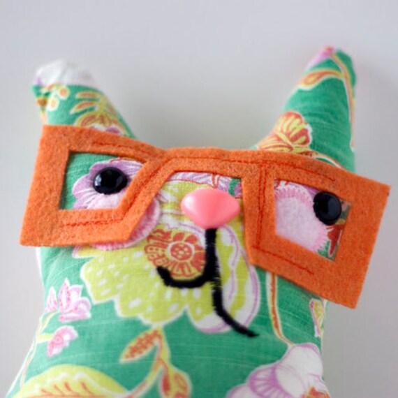 Citrine - orange spectacle wearing plush colorful cat