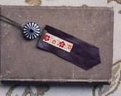 marya. a rocker-chic burgundy leather fringe necklace.