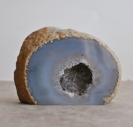 large agate geode specimen with smokey quartz interior