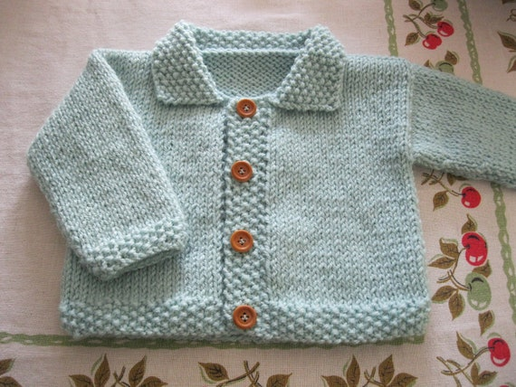 Hand knit baby sweater......light green cardigan with collar