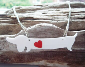 Betty the Sausage Dog acrylic necklace with an extra swappable heart