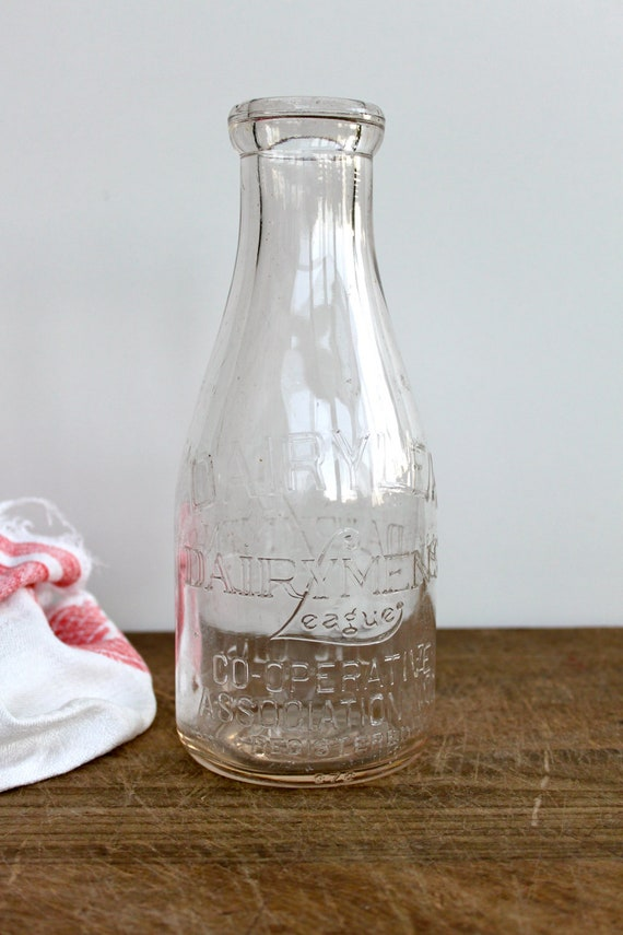 Vintage embossed milk bottle