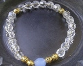 Baby Blue Accesory Bracelet (Clear Bracelet, Gold Accents, Sapphire Glass Bead)