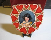 Very colorful and pretty  1930's embossed die cut and gold gilded valentine card two sided illustrations of little girls