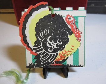 Vintage  1930's-40's die cut thanksgiving themed bridge tally card turkey in front of white picket fence gibson