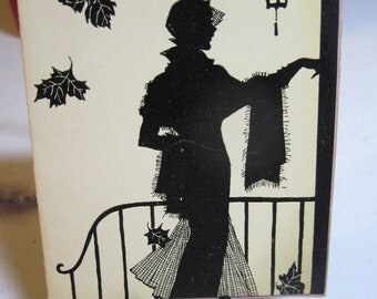 Gorgeous 1930's P.F. Volland bridge tally card with silhouette of dressed up sophisticated deco lady ringing a doorbell fall leaves