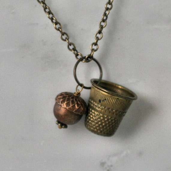 Acorn and Thimble Kisses Necklace Peter Pan and Wendy in Aged Brass
