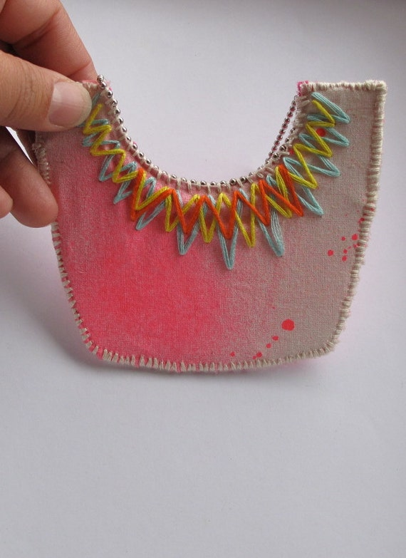 Neon pink bib necklace embroidered mint green orange and yellow triangles