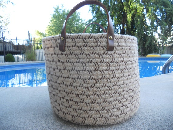 Wool braided basket in oatmeal with brown accents,leather handles & solid brass rivets
