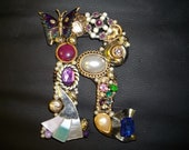 """Vintage and repurposed jewelry mounted on wooden letter """"R"""""""