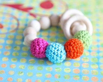 Multicolor teething ring toy with crochet wooden beads. Rattle for baby.