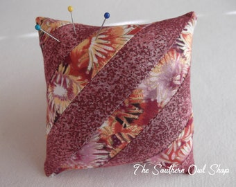 Pink diagonal stripe pieced quilt block pin cushion