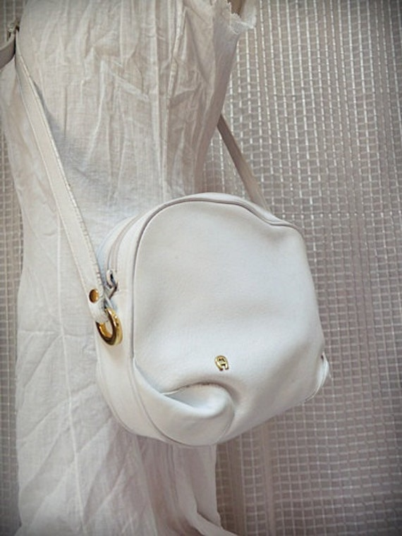 Vintage Etienne Aigner handbag purse Crossbody soft white leather and brass hardware with adjustable buckle strap