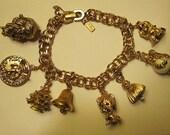 Vintage Monet Gold Tone Charm Bracelet