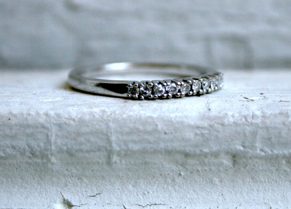 Sweet 9K White Gold Diamond Wedding Band - 0.20ct.