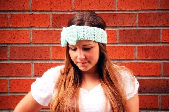 women's crochet ear warmer headband in mint green with oversize bow.