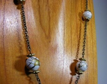 White and antiqued gold chain necklace