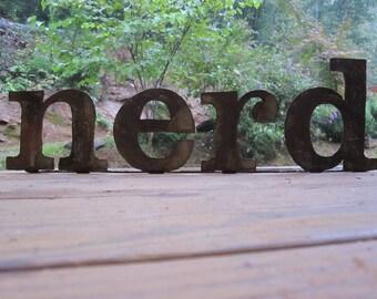 "Metal ""nerd"" on stand"